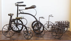 A lot consisting of four wrought iron tricycles
