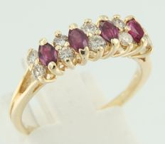Yellow gold ring 14 kt, set with 4 marquise shape, cut ruby and 10 brilliant cut diamonds.