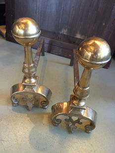 A set of brass andirons