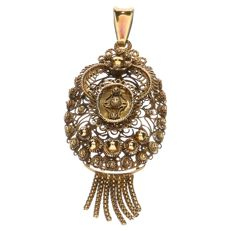 Antique finely tooled yellow gold pendant