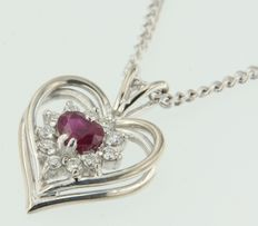 White gold 14 kt necklace, with an 18 kt white gold, heart pendant,  set with a heart shape, cut ruby and an entourage of brilliant cut diamonds.