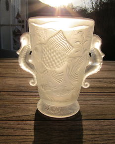 Vase of glass with seahorses decoration