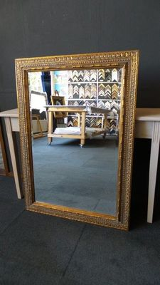 Large mirror with facet - Antique gold - Wide ornamental frame - France - 20th century