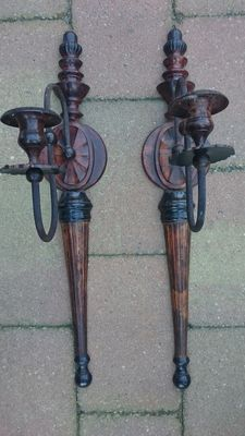 A few large cast iron wall sconces