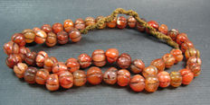 A Carnelian prayer bead necklace - Himalayan region - 2nd half of the 20th century.