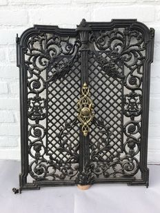 Two cast iron doors as a screen for a fireplace - France - approx. 1880