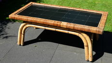 Exclusive rattan coffee table with  inlaid black tiles