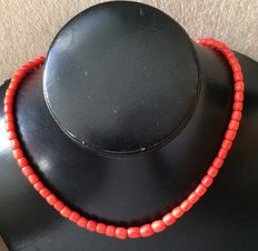 Red coral necklace with gold spherical clasp