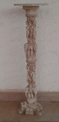 Column statue with vase holder depicting women, elephants and dragons