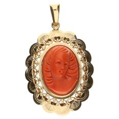 Yellow gold pendant set with a red coral cameo.