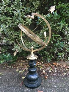 Sundial brass on aluminium foot.
