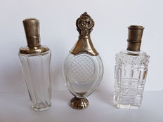Three perfume bottles with silver frames and caps, Netherlands, 1814-1953