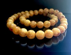 Necklace of Baltic amber round beads of ø10 mm, 26.4 grams
