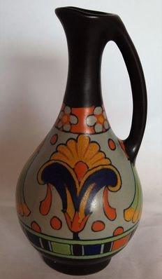Plateelbakkerij Zuid Holland - Small jug with decor Goes, and a bottle vase with decor Lotus