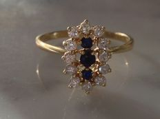 Bague or 18 k serti de diamants et saphir
