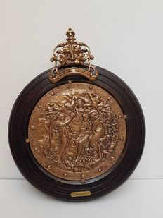 Heavy bronze round plaque in wooden frame.