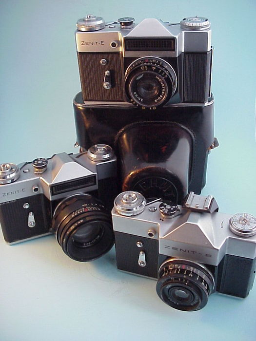 Three Russian 35 mm reflex cameras: 2 x Zenit-E with Industar-50-2  3.5/50 mm and Helios 44-2 2/58 mm lens and a Zenit-B