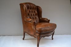 Walnut and leather armchair, 20th c.
