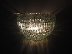 Handmade wall lamp of glass rods