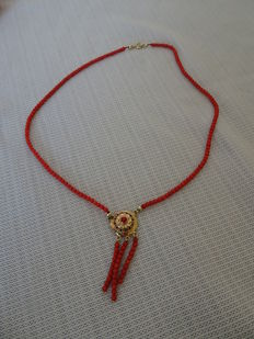 Red coral necklace with gold pendant and red coral beads