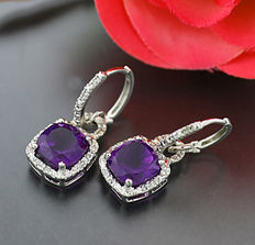 A pair of silver amethyst diamond earrings, totalling approx. 5.70ct