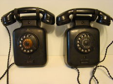 Two bakelite wall telephones, ca 1950, Netherlands