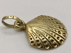 Handmade gold necklace pendant in the shape of a shell.