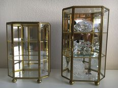 Two miniature display cabinets of glass and brass-one filled with six miniatures of crystal.