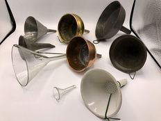 Collection of antique funnels among others 19th century