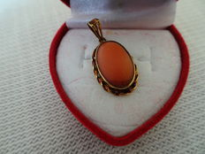 Gold pendant with red coral