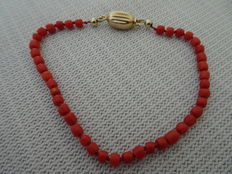 Red coral bracelet with gold clasp