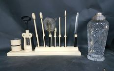 Eight piece cocktail tool set and antique glass shacker with silver