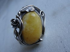 Silver handmade ring with amber, egg yolk colour