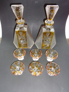 A cut glass liquor set consisting of two decanters with six glasses, the  Netherlands, first half 20th century
