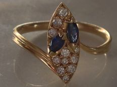 18 kt gold ring set with diamonds and sapphires.