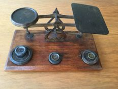 Antique English brass letters scale around 1900.