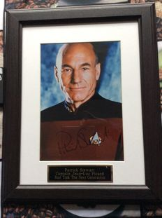 Star Trek Next Generation - signed photo by Patrick Stewart as Captain Jean Luc Picard - size incl frame 45cmx37cm