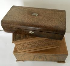 Three wooden storage boxes