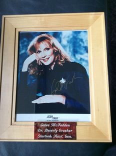Star Trek Next Generation - signed photo by Gates McFadden as Dr. Beverly Crusher - size incl frame 28cmx33cm