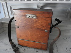 Antique electricity meter in wooden box