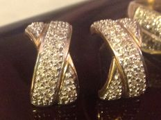 Earrings in 18 kt gold and diamonds