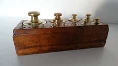 Complete set weights in wooden block - calibrated - ca. 1920
