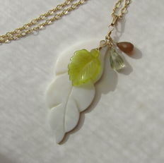 Gold necklace with large mother of pearl leaf, chalcedony and lemon topaz in melon-shape.