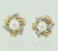 14 kt bi-colour gold ear studs set with a cultured pearl and 6 octagonal cut diamonds