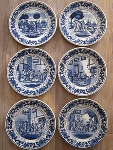 6 Delft blue wallplates with representations of the tobacco trade