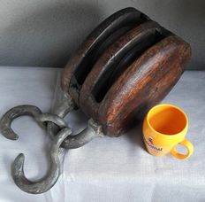 Antique large wooden pulley with wooden  rollers and unique iron hooks