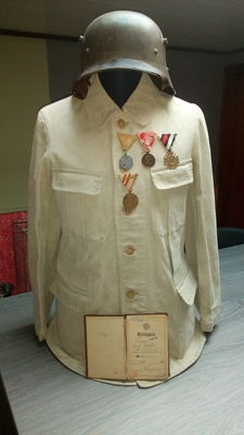 Austrian uniform jacket, Austrian stahlhelm, Austrian military passport and 4 Austrian medals 1914/1918