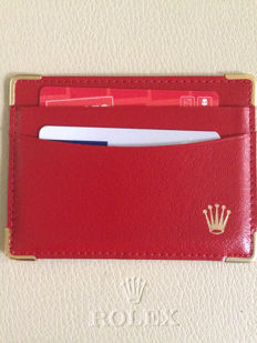 Rolex red leather credit card holder.