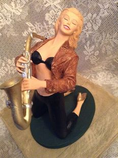 Flaming Jezebelle statue with saxophone