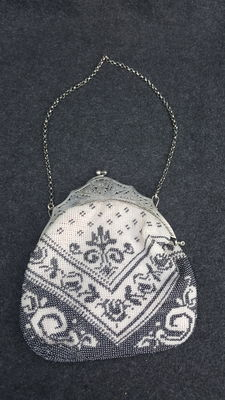 Evening bag with stamped silver brace - chain is also in silver, Netherlands, 20th century